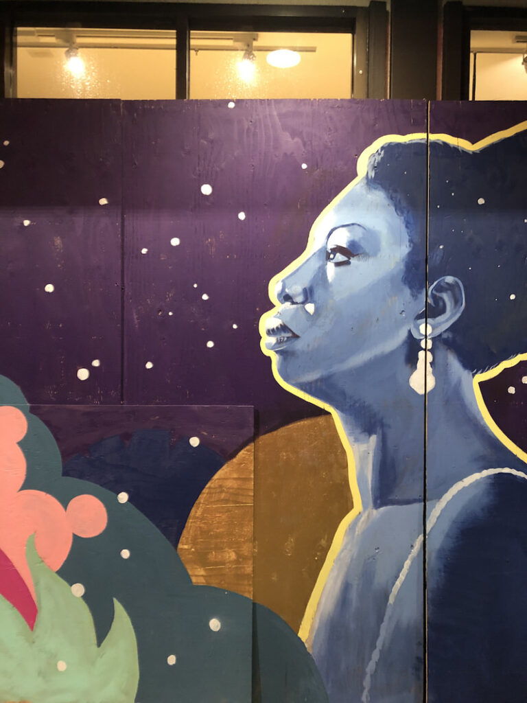 A mural of Nina Simone in an abstract nightscape