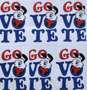 """A cartoony animal holds a heart on multiple posters that read """"GO VOTE"""""""
