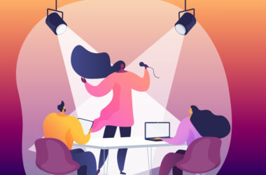 Illustration of a woman performing under spotlights in front of two people at a conference table with laptops open
