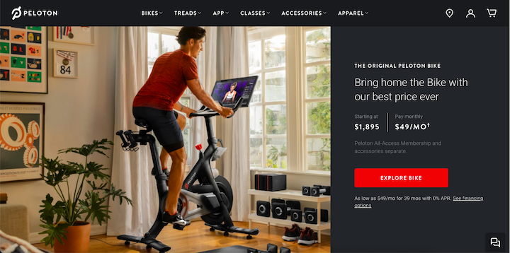 Screenshot of Peloton's website, with a rider on a Peloton in front of a large window with neatly arranged home gym equipment underneath.
